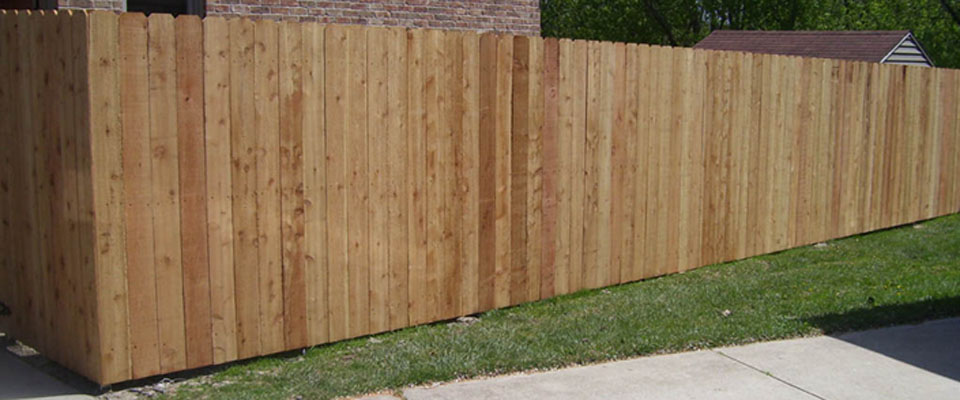 Custom built wood privacy fencing looks perfect in any landscape.
